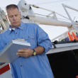 Mechanic Writing Notes On Clipboard Against Truck — Stok Fotoğraf #21969977
