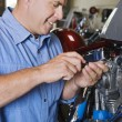 Stock Photo: Mechanic Repairing Motorcycle Engine