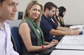 Female Student With Classmates In Computer Lab — Stock Photo