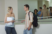 Two Friends Communicating At Corridor — Stock Photo