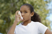 Girl Using Asthma Inhaler — Stock Photo