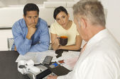 Financial Advisor In Discussion With Clients — Stock Photo