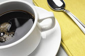 Coffee Cup With Napkin And Spoon — Stock Photo