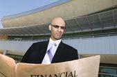 Businessman Reading A Financial Newspaper — Stock Photo