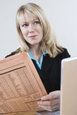 Businesswoman With Newspaper And Laptop — Stock Photo
