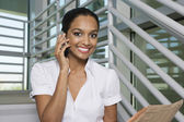Businesswoman With Newspaper On Call — Stock Photo