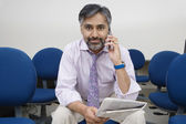 Businessman Holding Newspaper While On Call — Stock Photo