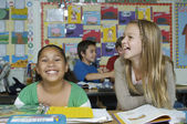 Female Friends Laughing In The Classroom — Stock Photo