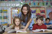 Teacher Assisting Students — Stock Photo