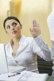 Businesswoman Showing Stop Gesture To Her Colleague — Stock Photo