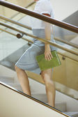 Businesswoman Moving Up Stairs — Stock Photo