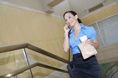 Businesswoman Holding Take Away Food While On Call — Stock Photo