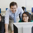 Teacher and Students in Computer Lab — Stock Photo #21973455