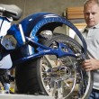 Mechanic Fixing Motorcycle - Stockfoto