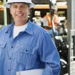 Stock Photo: Male Industrial Worker Holding Clipboard