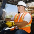 Confident Worker Driving Forklift At Workplace — Stock Photo