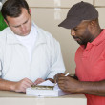 Mechanic Showing Customer An Invoice — Stock Photo