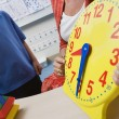 Teacher Showing Class A Clock — Stock Photo