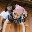 Kids Playing In Playhouse - Stock Photo