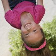 Little Girl Hanging Upside Down — Stock Photo #21970569
