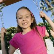 Stock Photo: Young Girl Swaying On Swing