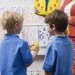 Stock Photo: Schoolboys Learning To Tell Time