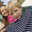 Stock Photo: Little Kids on Slide