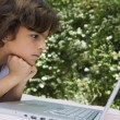 Boy Looking At Laptop - Foto Stock