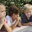 Shocked Little Kids Looking At Laptop - Stock Photo