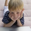 Stock Photo: Little Boy Using Laptop