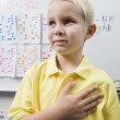 Stock Photo: Schoolboy With His Hand Over Heart