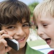 Stock Photo: Young Boys Using Cell Phone