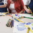 Teacher Watching Students Paint — Stockfoto