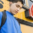 High School Boy Listening To MP3 Player — Stock Photo