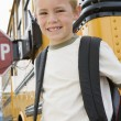 Boy Standing By School Bus — Stock Photo