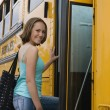Teenage Girl Getting On School Bus — Stock Photo #21971917