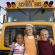 Students Standing In Front Of School Bus — Stock Photo #21971929