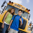 Stock Photo: Teenagers By School Bus