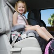 Girl Sitting In Booster Seat — Stock Photo #21971997