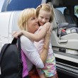 Stock Photo: Grandmother Hugging Daughter