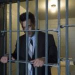 Businessman Standing Behind Bars — Stock Photo