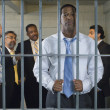 Stock Photo: Group Of Men In Prison Cell
