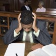 Stock Photo: Depressed Lawyer Sitting In Court