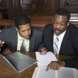 Lawyer With Businessman In Court — Stock Photo #21972363