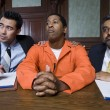 Lawyers With Criminal In Court - Stock Photo