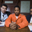 Criminal And Lawyers Sitting In Courtroom — Stock Photo