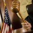 Judge Striking Gavel In Courtroom - Stock Photo