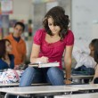 Female Student Writing Notes In Classroom — Foto Stock