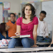 Stock Photo: Female Student In Classroom With Friends