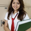 High School Girl Holding Textbook By School Lockers — Stockfoto